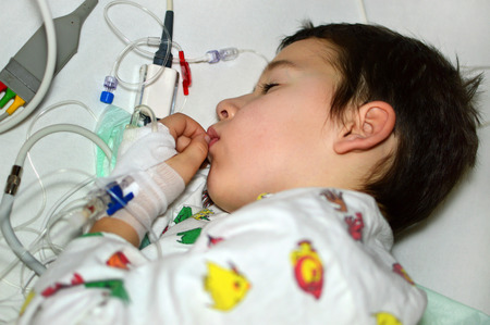 sickroom: little boy is in the hospital under general anesthesia