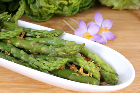 nutriment: fresh green asparagus cooked with fried onions Stock Photo