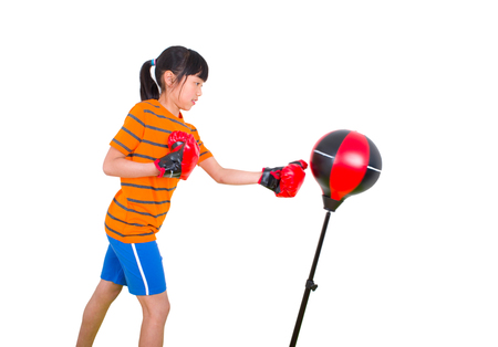 punching bag: Girl boxing on a punching bag Stock Photo