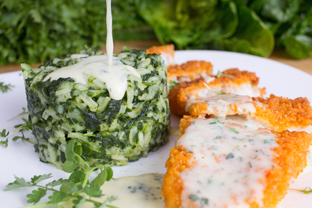 fish fillet: Spinach risotto crispy breaded fish fillet