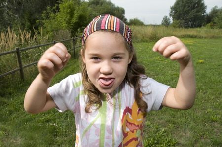 witty: Little childish girl cuts grimaces