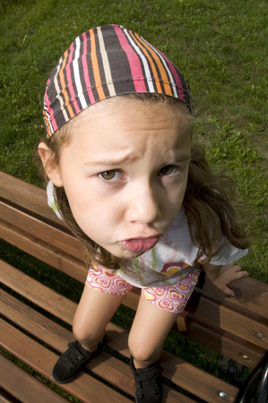 witty: Little girl with big head sulking
