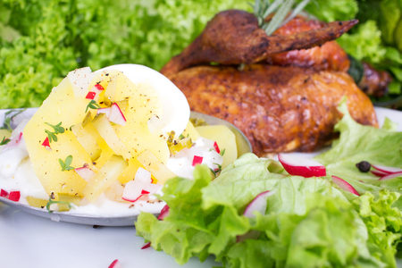 Grilled chicken with potato salad of East German type