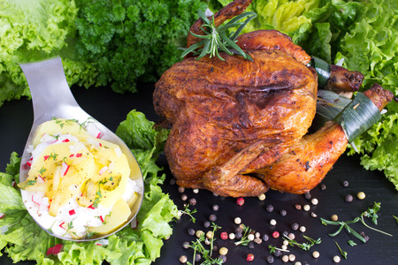 Roast chicken with potato salad with cucumber and egg