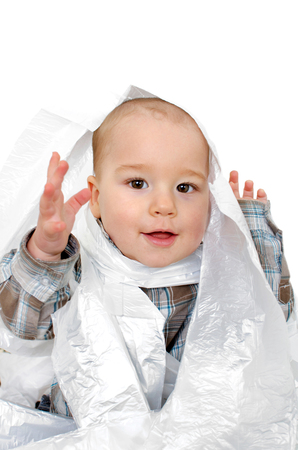stifle: Baby playing with plastic bags