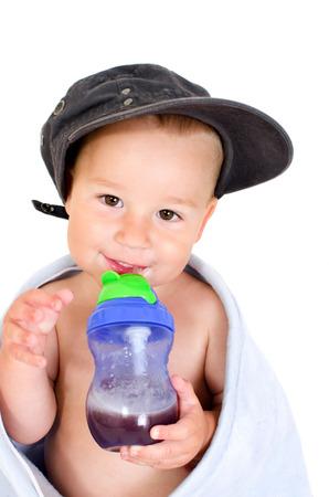 Little boy with a drinking bottle