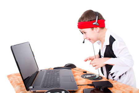 little boy as pirate on Notebook Stock Photo