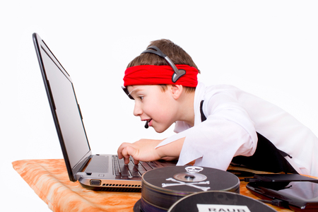 Little boy as a data pirate on the notebook
