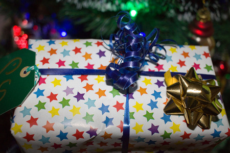 Gift in star paper for Christmas Stock Photo