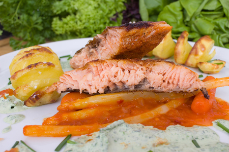 grilled salmon with asparagus in paprika chutney and potato spirals Stock Photo