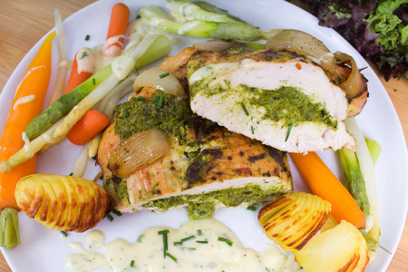 Turkey breast with herb-bears garlic filling, asparagus, carrots and fan potatoes