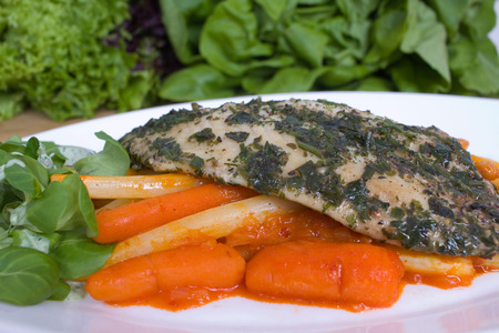 Fish fillet with asparagus and carrots in Papria chutney Stock Photo