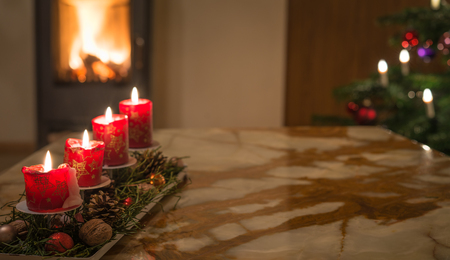 advent candles: Advent candles with Christmas tree and burning chimney fire