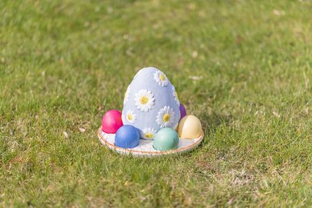 Colorful easter eggs on green grass Reklamní fotografie