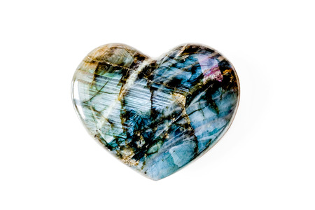 Heart made of precious stone in front of white background Stock Photo