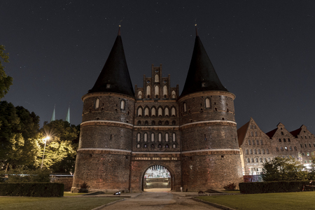 Holstentor in Luebeck at night with stars Editorial