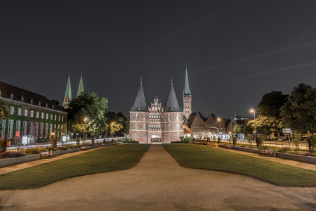 Holstentor in Luebeck at night Editorial