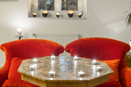 marqueteria: Candles on a antique side table with intarsia and red chair