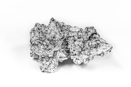 Crumpled aluminum foil on white background Banco de Imagens