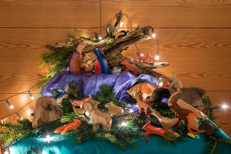 josef: Crip with fairy lights and alot of different wood animals