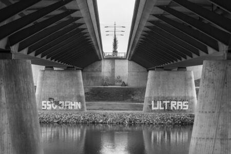 Germany, Regensburg, March 01, 2017, street photography of a bridge in Regensburg over the Danube river with graffiti about the local football club.