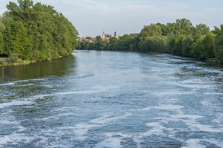 The River Danube after the stream weir with the view to the city of Regensburg