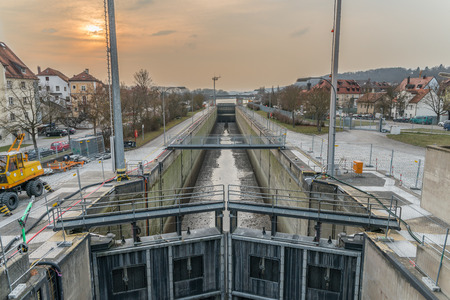 general cultural heritage: Protzenweiher bridge and Watergate of the Europe canal in Regensburg during cleaning procedure