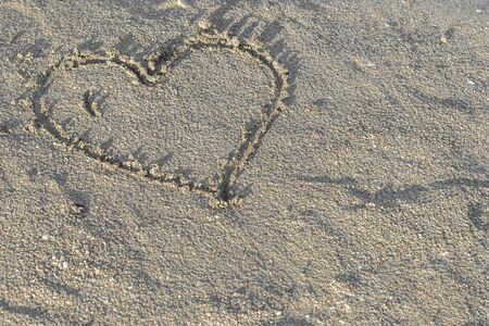 signed: Heart in wet sand