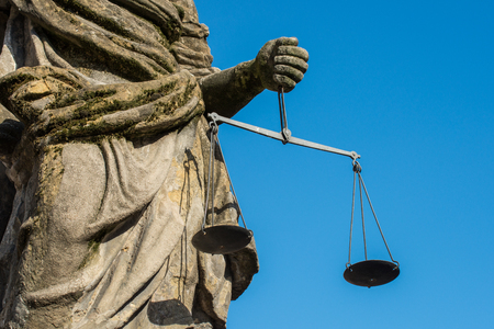 Closeup of the Justitia well in Regensburg with scales in her hands Stock Photo