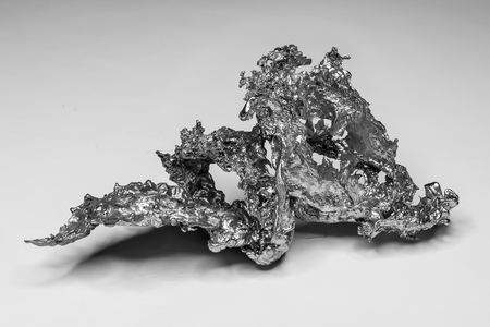 Nugget of a solidified metal in black and white