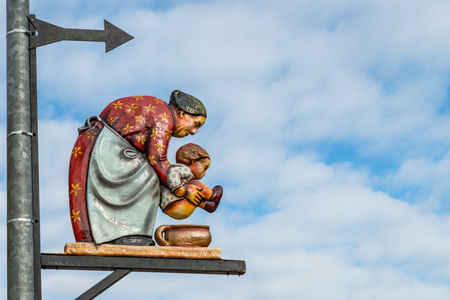 Regensburg, Bavaria, Germany, May 25, 2017, Toilet sign with an old woman holding a child at a folk festival in Regensburg Editorial