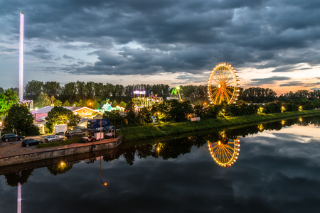 Night shot of folk festival with ferris wheel in Regensburg