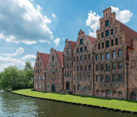View to the river Trave and the salt storage house in Luebeck Banco de Imagens - 84395200