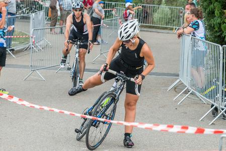 Regensburg, Bavaria, Germany, August 06, 2017, 28th Regensburg Triathlon 2017, Downswing of a bike racer in the transition area Editorial