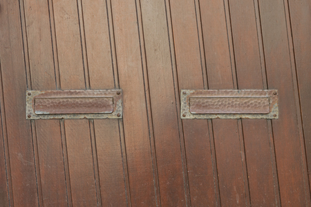 Wooden door with two mail slots
