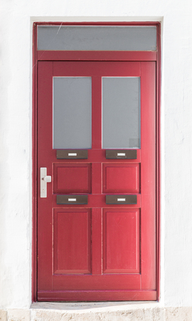 Vintage red wooden front door with four, Regensburg, Germany