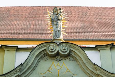 Madonna statue at the north portal of the collegiate church, old chapel, in Regensburg, Germany