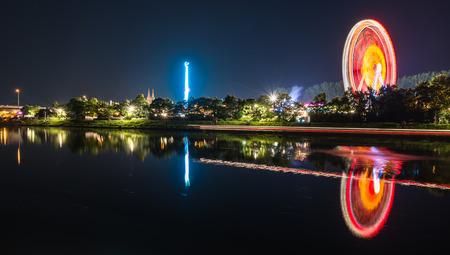 Night shot of folk festival with ferris wheel in Regensburg, Germany