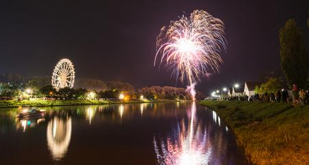 Firework at autumn folk festival with ferris wheel in Regensburg, Germany