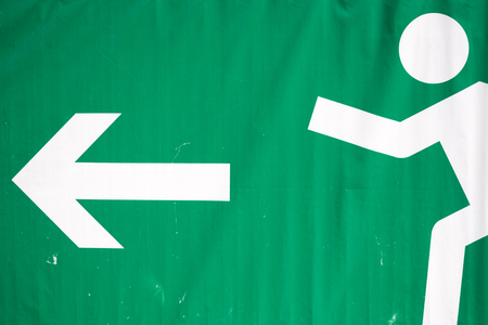 Big Emergency Exit Sign on a tarpaulin Stock Photo