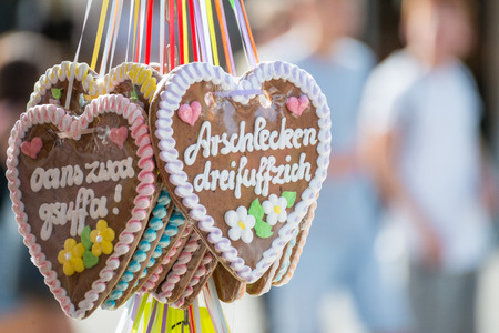 Gingerbread heart at a folk festival with german words Imagens