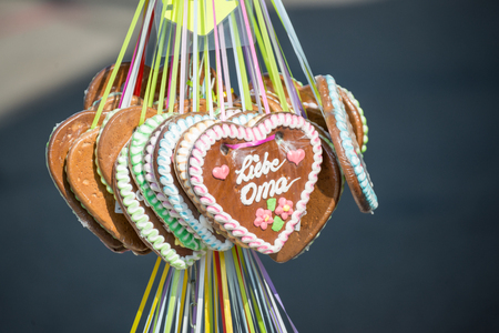 Gingerbread heart at a folk festival with german words - my loved grandma, Germany