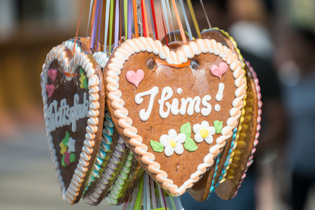 Gingerbread heart at a folk festival with german words - it is me, Germany Imagens