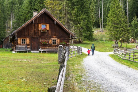Alpine cabin and Hiker in Weisspriachtal in Lungau, Austria Stock Photo