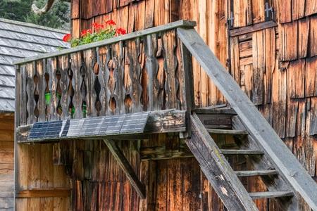 Wooden alpine cabin with solar panel, Austria