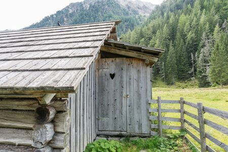 Wooden latrine of an alpine cabin in the mountains, Austria