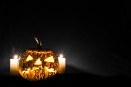 Halloween pumpkin in front of black background