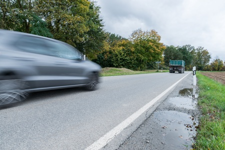 Car passing by on a national highway, Germany Stock Photo