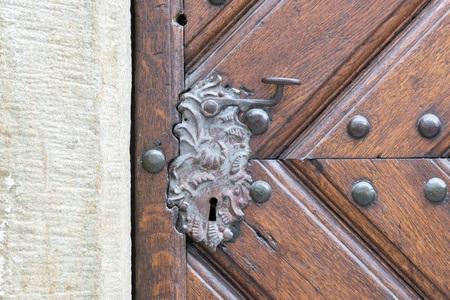 Vintage door handle on a wooden front door Stock Photo
