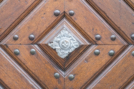 Vintage door handle on a wooden front door Stock Photo